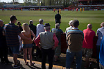 Home supporters watching the second-half action as Ilkeston Town (in red) host Walsall Wood in a Midland Football League premier division match at the New Manor Ground, Ilkeston. The home team were formed in 2017 taking the place of Ilkeston FC which had been wound up earlier that year. Watched by a crowd of 1587, their highest of the season, the match was top versus second, however, the visitors won 4-0 and replaced their hosts at the top of the division on goal difference with two matches to play