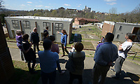NWA Democrat-Gazette/ANDY SHUPE<br /> Members of the Fayetteville Housing Authority Board of Directors and members of the public speak Friday, March 30, 2018, during a tour of Willow Heights in Fayetteville. The board this year has to come up with a capital improvements plan, per U.S. Department of Housing and Urban Development regulations.
