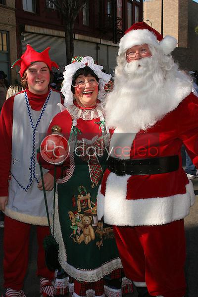 Santa Claus, Mrs. Claus and Santa's helper