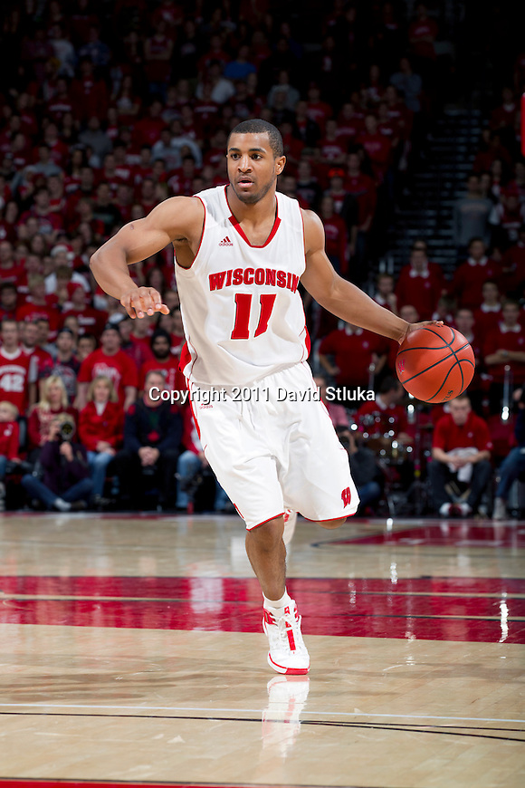 Wisconsin Badgers guard Jordan Taylor (11) handles the ball during an NCAA college basketball game against the UNLV Rebels on December 10, 2011 in Madison, Wisconsin. The Badgers won 62-513. (Photo by David Stluka)