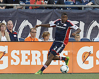 New England Revolution defender Andrew Farrell (2) controls the ball and looks to pass. In a Major League Soccer (MLS) match, the New England Revolution (blue) tied D.C. United (white), 0-0, at Gillette Stadium on June 8, 2013.