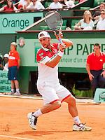 30-05-12, France, Paris, Tennis, Roland Garros, Roger Federer  Adrian Ungur  Robin Haase/Jarkko Nieminen