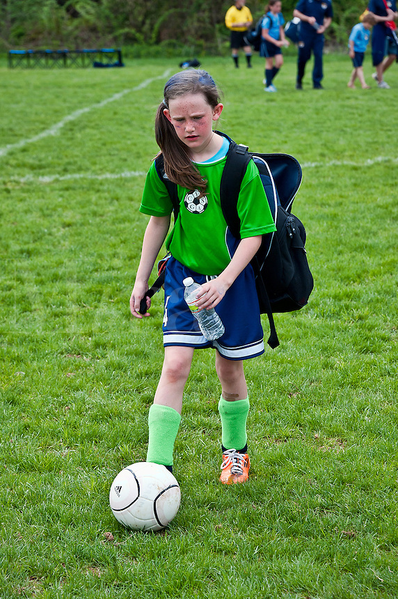 Young girl after a soccer game.