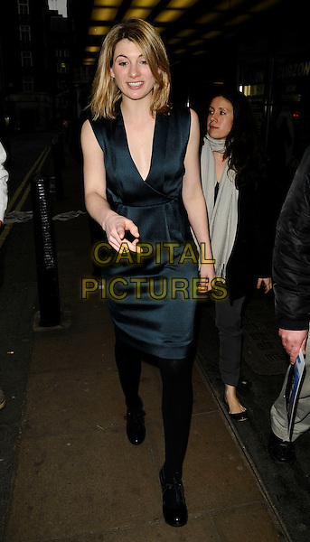 """JODIE WHITTAKER .At the """"Good"""" Screening and Q & A session, Curzon Mayfair cinema, London, England, UK, March 30th 2009..full length dark  green dress silk satin  Q&A and low cut black tights silk satin shoes looking down .CAP/CAN.©Can Nguyen/Capital Pictures"""