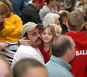 Hythem Salem holds his daughter Sophia 8, in the gym at the Pennridge High School in Perkasie, Pa. during a wrestling match in which twins Jake and Sam compete. Sophia is a twin to Joseph and her brothers and sisters are also twins. The Salem children, 3 sets of twins, are from Russia. Sophia and twin Joseph were adopted at 11 months of age by Hythem and his wife Lisa. The other twins were adopted just 20 months ago. All children are thriving in school and socially. photo by jane therese