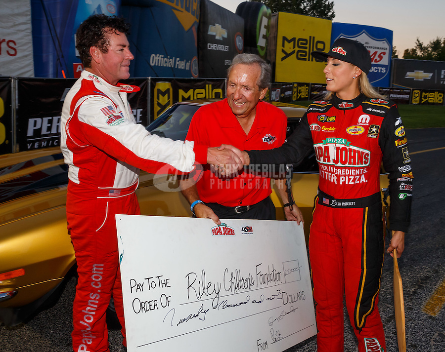 Sep 2, 2016; Clermont, IN, USA; apa Johns pizza founder John Schnatter (left) with NHRA team owner Don Schumacher (center) and top fuel driver Leah Pritchett during qualifying for the US Nationals at Lucas Oil Raceway. Mandatory Credit: Mark J. Rebilas-USA TODAY Sports