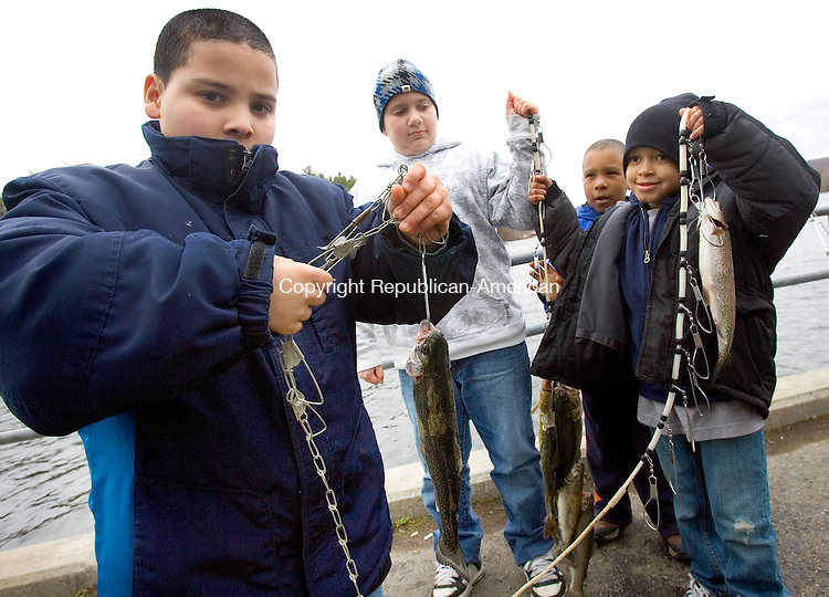 WATERBURY, CT. 16 March 2011-041611SV12--From left, Jeremiah Coney, 9 of Seymour, Jason Lewicki, 11, Jaden Lawrence, 8, of Wolcott, and Ryan Mullen, 7, of Waterbury show off some of the fish they caught with their families while fishing at Scoville Reservoir in Wolcott Saturday.<br /> Steven Valenti Republican-American