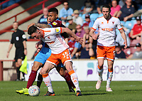Blackpool's Jordan Thompson battles with Scunthorpe United's Funso Ojo<br /> <br /> Photographer David Shipman/CameraSport<br /> <br /> The EFL Sky Bet League One - Scunthorpe United v Blackpool - Friday 19th April 2019 - Glanford Park - Scunthorpe<br /> <br /> World Copyright © 2019 CameraSport. All rights reserved. 43 Linden Ave. Countesthorpe. Leicester. England. LE8 5PG - Tel: +44 (0) 116 277 4147 - admin@camerasport.com - www.camerasport.com