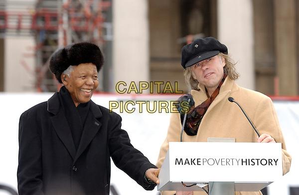 NELSON MANDELA & BOB GELDOF.MAKE poverty HISTORY - Rally, Trafalgar Square, WC2, London.February 3rd, 2005.half length,  podium, microphone, speech, furry black hat.www.capitalpictures.com.sales@capitalpictures.com.©Capital Pictures
