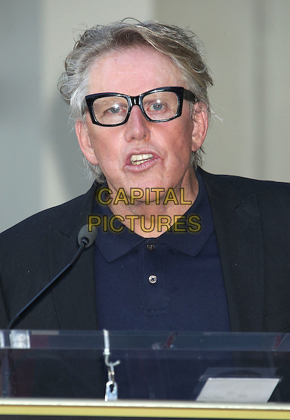 "Gary Busey .Buddy Holly posthumous STAR Induction into ""The Hollywood Walk of Fame"" on his 75th Birthday held in front of the Capital Records Building on Vine Street, Hollywood, California, USA..September 7th, 2011.headshot portrait mouth open black jacket blue top podium speech glasses .CAP/ADM/RE.©Russ Elliot/AdMedia/Capital Pictures."