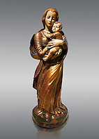 Gothic wooden statue of Madonna and Child by Seguidor de Diego de Siloe of Burgos, circa 1530-1540, tempera and gold leaf on wood, from the church of San Miguel de Medina del Campo, Valladolid..  National Museum of Catalan Art, Barcelona, Spain, inv no: MNAC  131050.