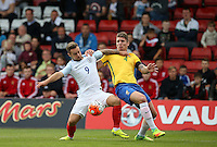 Adam Armstrong (Barnsley, loan from Newcastle United) of England holds off Lyanco (Captain) of Brazil during the International match between England U20 and Brazil U20 at the Aggborough Stadium, Kidderminster, England on 4 September 2016. Photo by Andy Rowland / PRiME Media Images.