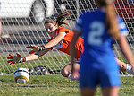 Douglas keeper Corryne Millet dives for the ball during the Douglas and Carson girls soccer match in Minden, Nev., on Friday, Oct. 10, 2014. Douglas won 2-1 to go 14-0 on the season. <br /> Photo by Cathleen Allison