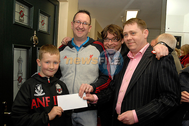 Kennethh Donnelly from Ashfield is presented with a cheque for750 euro which he won at the opening of Senator Windows on Saturday. With him is his son Aaron (9), Chris Fitzpatrick and Gary Moran of Senator WIndows. Photo:www.newsfile.ie