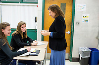 Teacher Sandra Haupt works with students as they complete a paper-folding exercise as part of an MIT Blossoms lesson on exponential growth in her Intro to Calc class at Concord-Carlisle Regional High School in Concord, MA, USA. The class has partnered with MIT Blossoms to use video education tools in conjunction with regular lessons to reinforce key concepts.