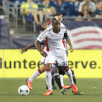 New England Revolution substitute forward Dimitry Imbongo (92) looks to pass. In a Major League Soccer (MLS) match, the New England Revolution (white) defeated San Jose Earthquakes (black), 2-0, at Gillette Stadium on July 6, 2013.