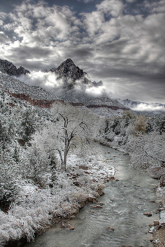 The Virgin River flows south towards The Watchman mountain after an autumn snowfall at Zion National Park
