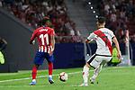 Atletico de Madrid's Thomas Lemar and Rayo Vallecano's Alex Moreno during La Liga match. August 25, 2018. (ALTERPHOTOS/A. Perez Meca)
