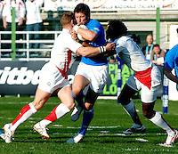 Photo: Omega/Richard Lane Photography. Italy v England. RBBS Six Nations. 10/02/2008. Italy's Ezio Galon is tackled by England's Jamie Noon and Paul Sackey.