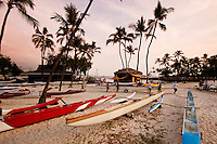 A team preparing an outrigger canoe for paddling, Kona, Big Island