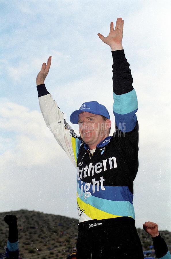 Nov. 4, 2000; Avondale, AZ, USA; NASCAR Busch Series driver Jeff Burton celebrates after winning the Outback Steakhouse 200 at Phoenix International Raceway. Mandatory Credit: Mark J. Rebilas-