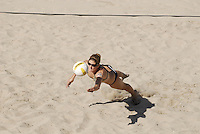 Huntington Beach, CA - 5/6/07:  Nicole Branagh dives for the ball during Branagh / Youngs' 21-14, 21-16 win over Boss / Ross in the semifinals of the AVP Cuervo Gold Crown Huntington Beach Open of the 2007 AVP Crocs Tour..Photo by Carlos Delgado