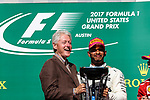Former President Bill Clinton and Mercedes driver Lewis Hamilton (44) of Great Britain on the podium after the Formula 1 United States Grand Prix race at the Circuit of the Americas race track in Austin,Texas.