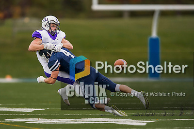 8 October 2016: Middlebury College Panther Defensive Back Kevin Hopsicker, a Junior from Delmar, NY, tackles Amherst College Purple & White Wide Receiver Devin Boehm, a Senior from Wilmette, IL, at Alumni Stadium in Middlebury, Vermont. The Panthers edged out the Purple & While 27-26. Mandatory Credit: Ed Wolfstein Photo *** RAW (NEF) Image File Available ***