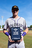 Salt River Rafters first baseman Tyler Nevin (2), of the Colorado Rockies organization, poses with the 2018 Arizona Fall League Batting Champion Award before the Arizona Fall League Championship Game against the Peoria Javelinas at Scottsdale Stadium on November 17, 2018 in Scottsdale, Arizona. (Zachary Lucy/Four Seam Images)