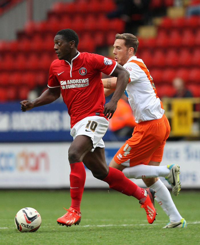 Blackpool's Dan Gosling and Charlton Athletic's Marvin Sordell  in action <br /> <br /> Photo by Kieran Galvin/CameraSport<br /> <br /> Football - The Football League Sky Bet Championship - Charlton Athletic v Blackpool -  Saturday 5th October 2013 - The Valley - London<br /> <br /> &copy; CameraSport - 43 Linden Ave. Countesthorpe. Leicester. England. LE8 5PG - Tel: +44 (0) 116 277 4147 - admin@camerasport.com - www.camerasport.com