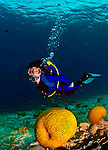 11 August 2009: SCUBA Diver Sally Herschorn discovers a brain coral formation at Captain Don's Reef in Hato, Bonaire. Mandatory Photo Credit: Ed Wolfstein Photo