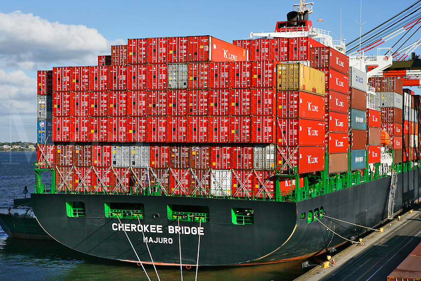 Cherokee Bridge Container Ship, Port Elizabeth, NJ.Loaded Container Ship.Red containers stacked 8 high, blue sky and late afternoon sun; even heavy industry has it's charms.