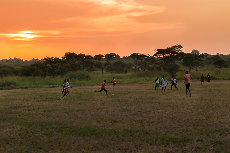 Students play soccer at Hope North, Uganda.