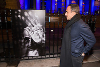 French-Greek TV host Nikos Aliagas speaks at journalist during the opening of Aliagas' photography exhibition, on January 16, 2017, in Paris.