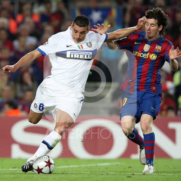Football - FC Barcelona v Inter Milan UEFA Champions League Semi Final Second Leg - Camp Nou Stadium, Barcelona, Spain - 28/4/10 Inter Milan's Lucio and  Lionel Messi of Barcelona