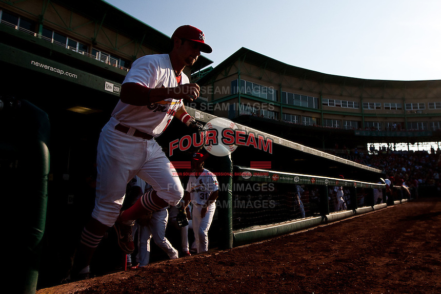 Greg Garcia (10) of the Springfield Cardinals runs onto the field prior to a game against the Arkansas Travelers at Hammons Field on May 5, 2012 in Springfield, Missouri. (David Welker/Four Seam Images)