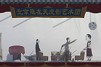 A modern Chinese shadow puppet show is being performed at a temple fair on February 19, 2010 in Beijing, China. The 2000-year-old art of Chinese shadow puppetry provides a vehicle for bringing together art and literature. Chinese continue to celebrate the Lunar Chinese New Year of the Tiger by visiting temple fair to watch traditional folk performances and eat local delicatessens.