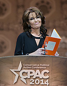 "Former Governor Sarah Palin (Republican of Alaska) reads a re-written version of the Dr. Seuss classic ""Green Eggs and Ham"" to attack the Democrats as she speaks at the Conservative Political Action Conference (CPAC) at the Gaylord National at National Harbor, Maryland on Saturday, March 8, 2014.<br /> Credit: Ron Sachs / CNP"