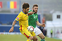 Romania's  Paul Papp is tackled by Northern Ireland's Stuart Dallas during the UEFA EURO 2016 qualifying Group F soccer match between Northern Ireland and Romania at Windsor Park in Belfast, Northern Ireland, 13 June 2015.  EPA/PauL McErlane
