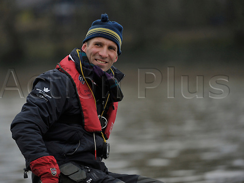 26.03.2013. River Thames, London.  Oxford coach Sean Bowden in action during The 159th Oxford and Cambridge Universities Boat Race practice outing during Tideway week.