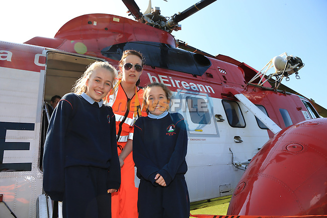 Penny Flood and Annie Woods and officer Liz Nevil pictured during the visit of the Irish Coast Guard Helicopter from Dublin Airport with members of the Irish Coast Guard Drogheda at Whitecross national school in Julianstown Co Meath.<br /> Picture:  Fran Caffrey / www.newsfile.ie