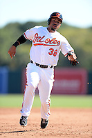 Baltimore Orioles outfielder Xavier Paul (38) during a spring training game against the Boston Red Sox on March 8, 2014 at Ed Smith Stadium in Sarasota, Florida.  Baltimore defeated Boston 7-3.  (Mike Janes/Four Seam Images)