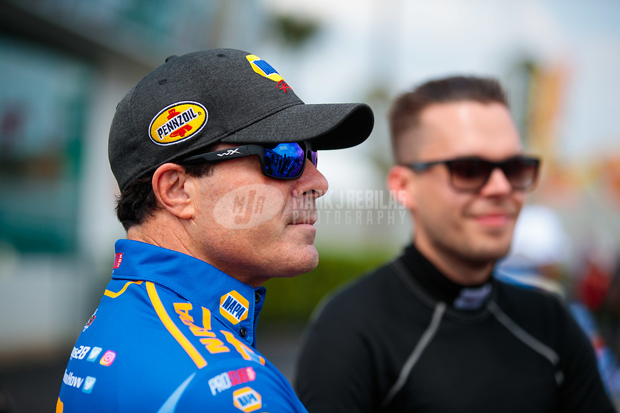 Mar 15, 2019; Gainesville, FL, USA; NHRA funny car driver Ron Capps (left) with Jonnie Lindberg during qualifying for the Gatornationals at Gainesville Raceway. Mandatory Credit: Mark J. Rebilas-USA TODAY Sports