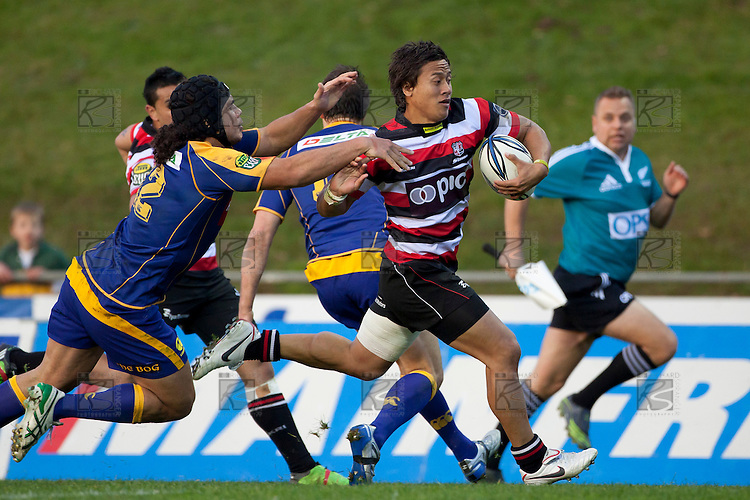 Tim Nanai Williams pushes away the attempted tackle Josh Tatupu as he heads for the tryline. ITM Cup Round 1 game between the Counties Manukau Steelers and Otago, played at Bayer Growers Stadium, Pukekohe, on Saturday July 31st 2010. Counties Manukau Steelers won 29 - 13 after leading 22 - 6 at halftime.