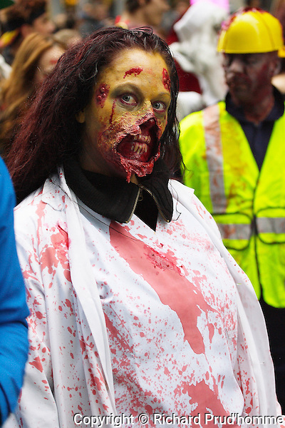 A bloodied deface female zombie walking in the Montreal zombie walk parade