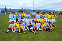The teams pose for a group photo after the 2019 Hurricanes Youth Council Under-15 Girls' Rugby Tournament match between Ngati Porou East Coast and Mana College at Playford Park in Levin, New Zealand on Tuesday, 3 September 2018. Photo: Dave Lintott / lintottphoto.co.nz