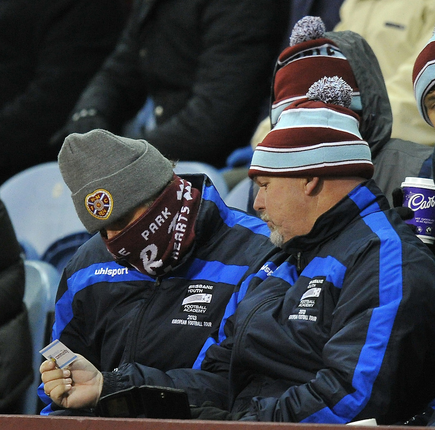 Burnley fans wrap up against the cold <br /> <br /> Photographer Dave Howarth/CameraSport<br /> <br /> Football - Barclays Premiership - Burnley v Newcastle United - Tuesday 2nd December 2014 - Turf Moor - Burnley<br /> <br /> &copy; CameraSport - 43 Linden Ave. Countesthorpe. Leicester. England. LE8 5PG - Tel: +44 (0) 116 277 4147 - admin@camerasport.com - www.camerasport.com