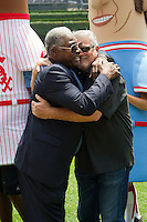 Former Chicago White Sox teammates Dick Allen and Bill Melton hug before the Major League Baseball game featuring the Chicago White Sox and the Milwaukee Brewers on June 24, 2012 at US Cellular Field in Chicago, Illinois. The White Sox celebrated the 40th anniversary of their memorable 1972 team. (Andrew Woolley/Four Seam Images).