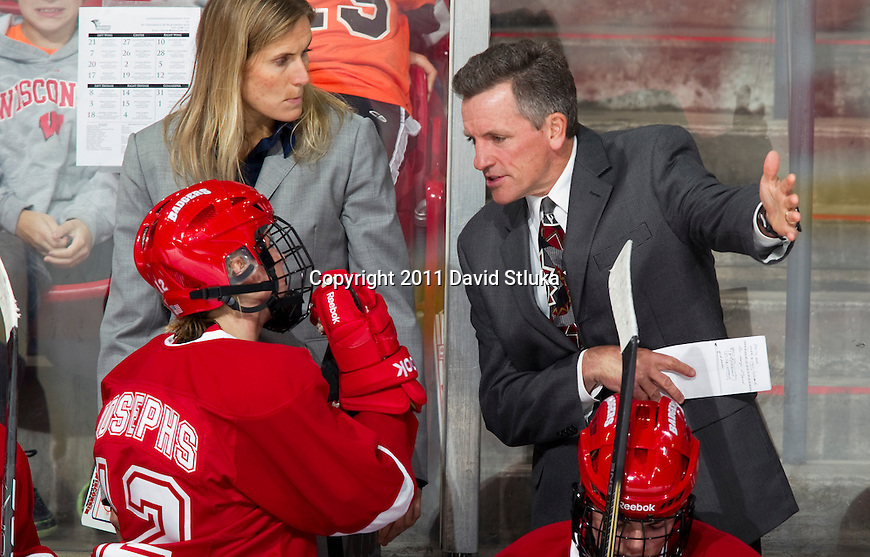 Wisconsin Badgers head coach Mark Johnson talks to one of his players during an NCAA Women's College Hockey game against Lindenwood University Lions on September 23, 2011 in Madison, Wisconsin. The Badgers won 11-0. (Photo by David Stluka)