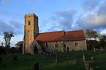 Church tower with flag winter evening light, church of Saint Margaret, Shottisham, Suffolk, England, UK